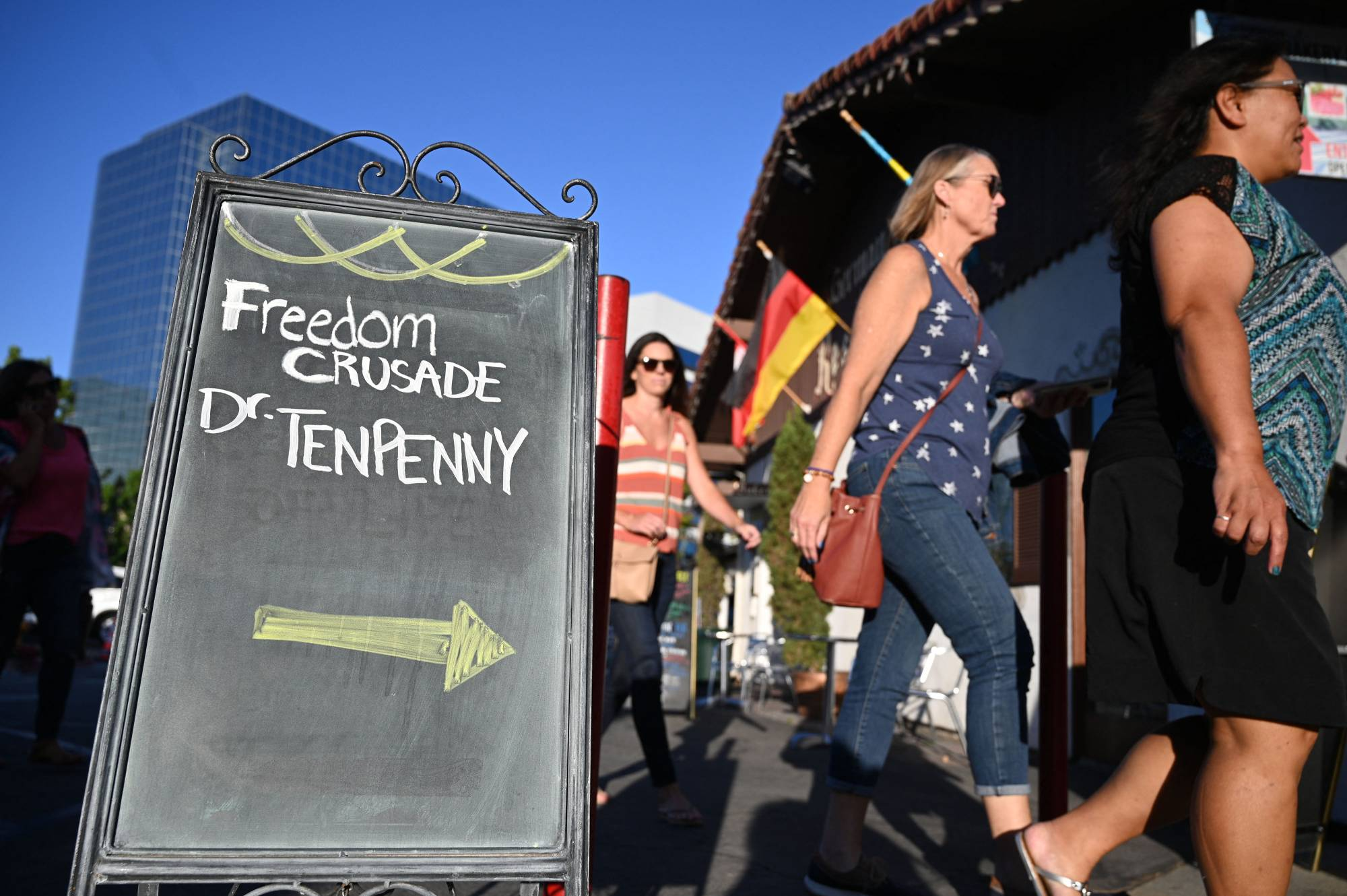 People arrive for an event in Huntington Beach, California, on Aug. 5, where Sherri Tenpenny was scheduled to speak.    AFP-JIJI