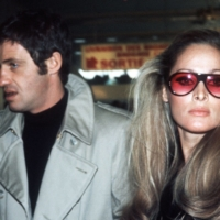 Belmondo arrives at Orly Airport with actress Ursula Andress in 1968.