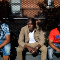 U.S. actor Michael K. Williams hangs with old friends at a basketball court in Brooklyn in June 2017.   DEMETRIUS FREEMAN / THE NEW YORK TIMES