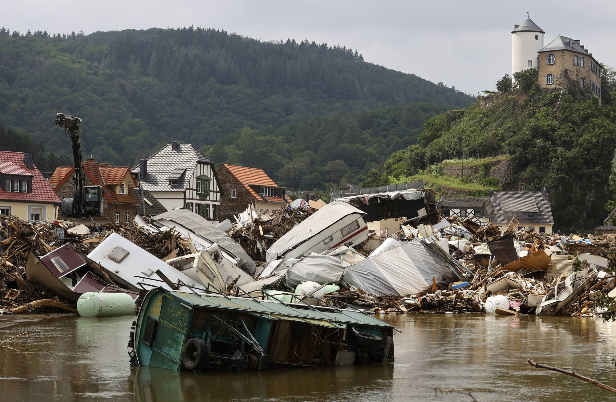 Destroyed caravans in an area affected by floods caused by heavy rainfall in Kreuzberg, Germany, on July 19   REUTERS