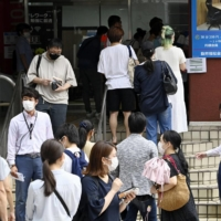 Japan considers use of vaccine passports for commercial activities