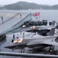 British Royal Navy F-35B fighter jets are seen on the deck of the aircraft carrier HMS Queen Elizabeth in Yokosuka, Kanagawa Prefecture, on Monday.   POOL  VIA KYODO