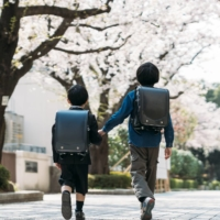 School backpacks in Japan have traditionally been black for boys and red for girls, although many more colors are now on offer. | GETTY IMAGES