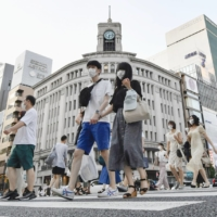 The revised GDP figures for the April-June quarter confirm that Japan avoided falling back into recession despite returning to a state of emergency.   KYODO