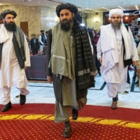 Mullah Abdul Ghani Baradar and his delegation attend the Afghan peace conference in Moscow in March. | POOL / VIA REUTERS