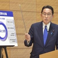 Former Liberal Democratic Party policy chief Fumio Kishida speaks about his economic policies during a news conference on Wednesday in Tokyo.   KYODO
