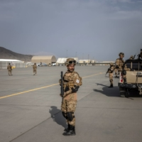 Taliban fighters at the airport in Kabul on Friday.  | JIM HUYLEBROEK / THE NEW YORK TIMES