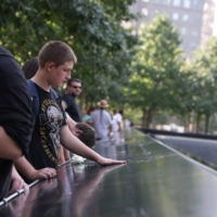 Students tour the 9/11 memorial in New York on Aug. 26.  | REUTERS
