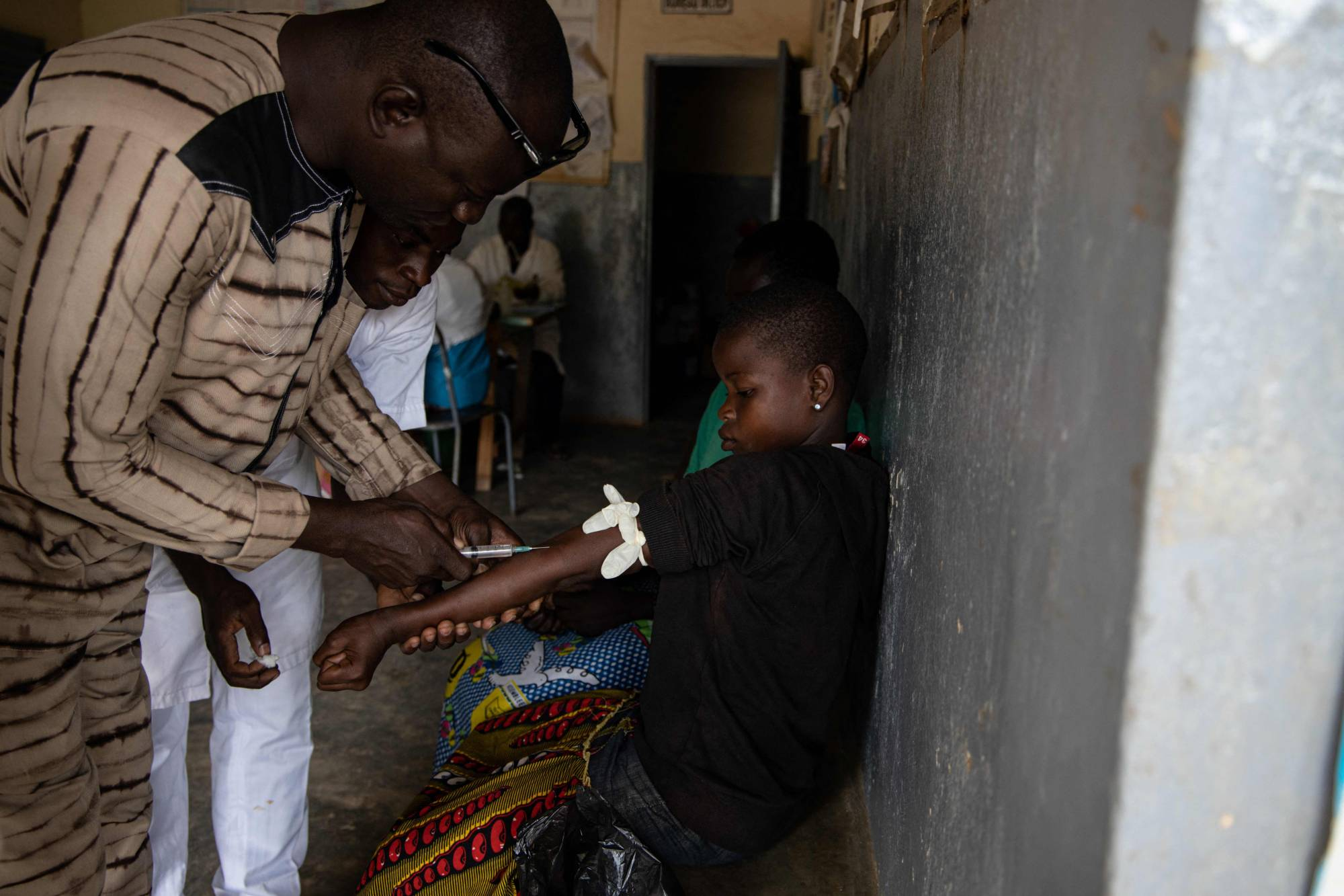 a girl is given an injection to cure malaria at a health center in Ziniare, Burkina Faso, in 2019,    AFP-JIJI