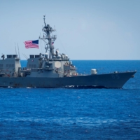 The guided-missile destroyer USS Benfold sails in formation in the Philippine Sea in June 2018.  | U.S. NAVY / VIA REUTERS