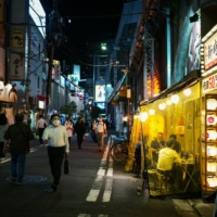 Although authorities request bars to refrain from selling alcohol and close by 8 p.m., many are choosing to keep their doors open. | RYUSEI TAKAHASHI