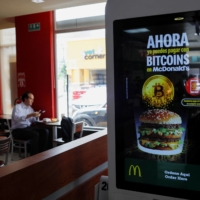 A sign that reads 'Now you can pay with your bitcoins' at a McDonald's in Antiguo Cuscatlan, El Salvador | REUTERS