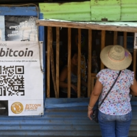 A woman buys items at a store that accepts bitcoin in El Zonte, El Salvador, on Saturday.  | AFP-JIJI