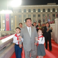North Korean leader Kim Jong Un attends a military parade to mark the 73rd founding anniversary of the country in Pyongyang's Kim Il Sung Square in this image released Thursday. | KCNA / VIA REUTERS