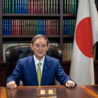 Yoshihide Suga poses for a portrait at his office after being elected as leader of the ruling Liberal Democratic Party on Sept. 14, 2020.   POOL / VIA AFP-JIJI
