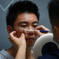 Men in China turn to cosmetic surgery to increase their odds at success