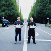 Yoshihiro Narisawa (left) and Hisato Hamada launched Onigiri for Love as a way to support rural producers and give back to Japan's health care workers.   COURTESY OF NARISAWA AND WAGYUMAFIA