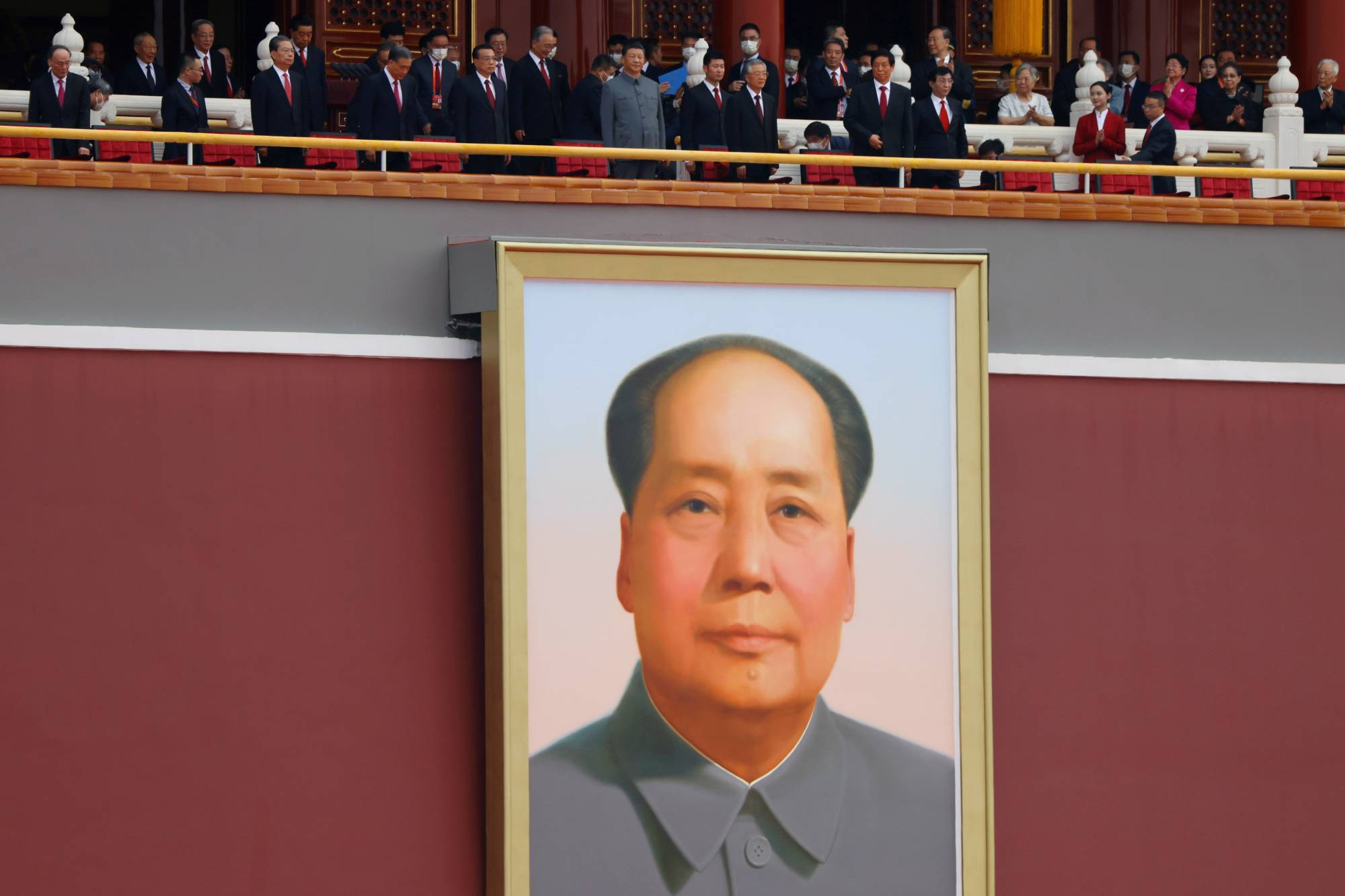 Chinese President Xi Jinping and other leaders stand above a giant portrait of late Chinese Chairman Mao Zedong on July 1. | REUTERS