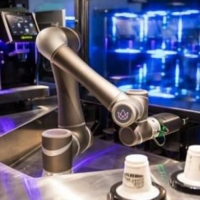The Ella autonomous robotic barista, built by a Singaporean firm in which JR East has invested, is capable of offering over 200 types of blended coffee. | EAST JAPAN RAILWAY CO. / VIA NNA/KYODO