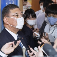 Former Defense Minister Shigeru Ishiba speaks to reporters in Tokyo on Wednesday. | KYODO