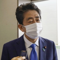 Former Prime Minister Shinzo Abe speaks to reporters in Ube, Yamaguchi Prefecture on Sep. 3. | KYODO