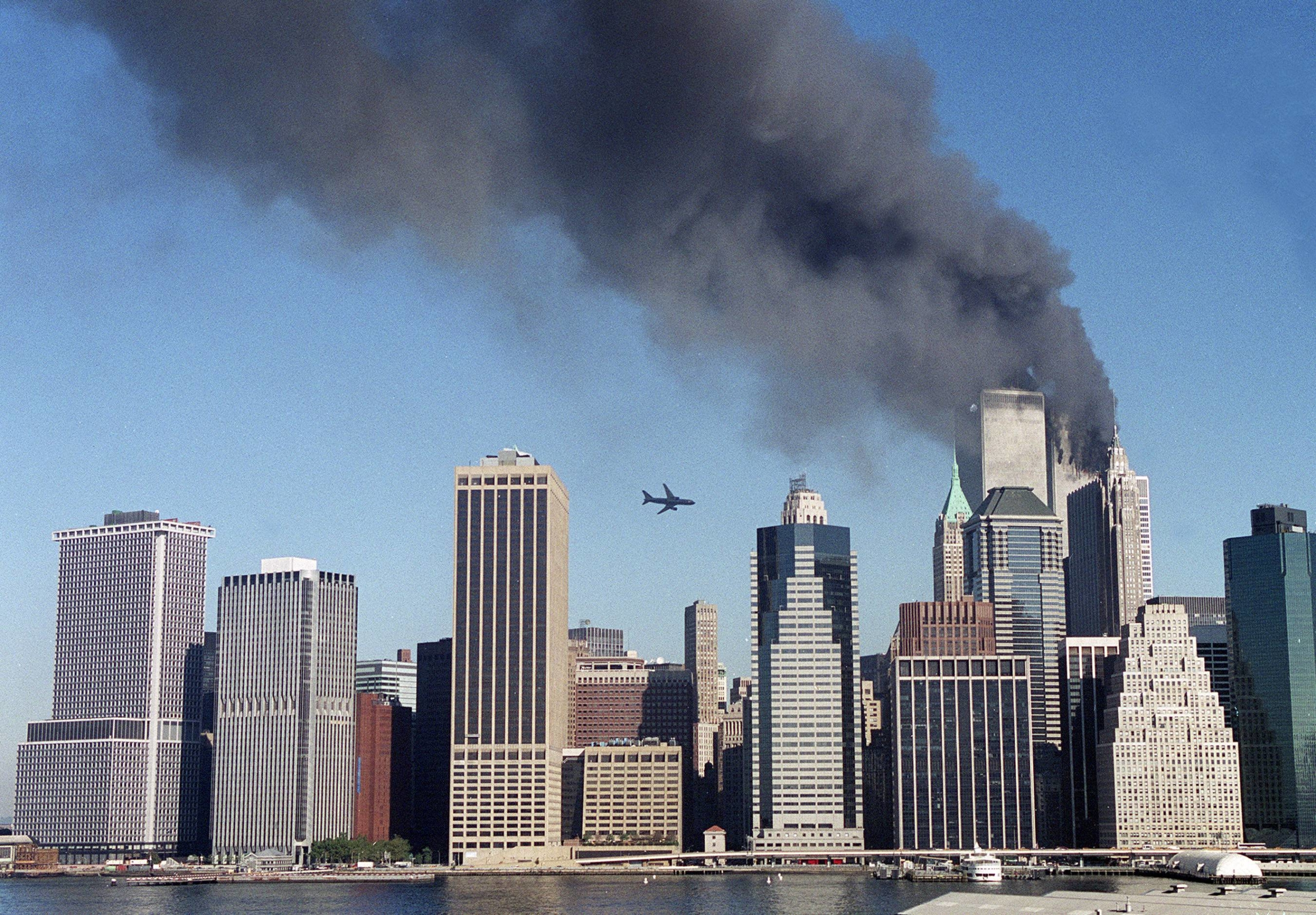 United Airlines Flight 175 approaches the South Tower of the World Trade Center in New York on the morning of Sept. 11, 2001, while the North Tower burns after it was struck by American Airlines Flight 11.   KELLY GUENTHER / THE NEW YORK TIMES
