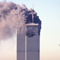 A hijacked commercial aircraft approaches the twin towers of the World Trade Center shortly before crashing into the landmark skyscraper in New York on Sept. 11, 2001.   AFP-JIJI