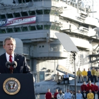 U.S. President George W. Bush addresses the nation aboard the nuclear aircraft carrier USS Abraham Lincoln on May 1, 2003.   AFP-JIJI