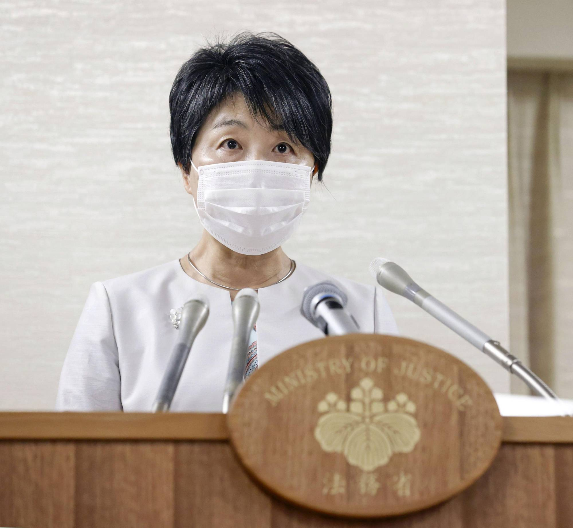Justice Minister Yoko Kamikawa speaks at a news conference at the ministry on Friday. | KYODO