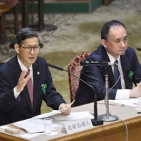 Shigeru Omi (left), head of the Japan Community Health Care Organization, and Masahiro Kami, executive director of the Medical Governance Research Institute, attend a public hearing of the Upper House Budget Committee on the coronavirus in Tokyo on March 10, 2020. | KYODO