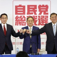 Liberal Democratic Party policy chief Fumio Kishida (left), Chief Cabinet Secretary Yoshihide Suga and former Defense Minister Shigeru Ishiba — the three LDP presidential candidates — pose at a joint news conference in Tokyo on Sept. 8, 2020. | KYODO