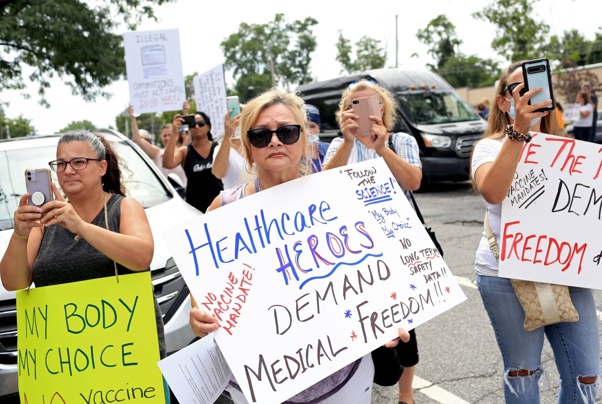 People protest vaccine mandates for health care workers at Staten Island University Hospital in Staten Island, New York, on Aug. 16.   YANA PASKOVA / THE NEW YORK TIMES