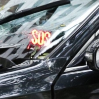 An emergency sign had been activated on a taxi that caused a deadly accident in Tokyo on Saturday.   KYODO