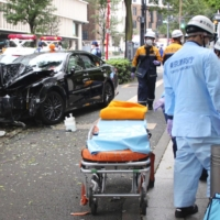 Two dead and four injured after taxi mounts sidewalk in Tokyo