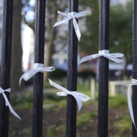 White ribbons tied to a fence in lower Manhattan on the 20th anniversary of 9/11 on Saturday | CHANG W. LEE/THE NEW YORK TIMES