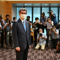 Taro Kono poses for photographers prior to a news conference announcing his run for leadership of the Liberal Democratic Party in Tokyo on Friday. | AFP-JIJI