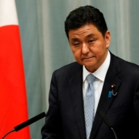 Japan says suspected Chinese submarine seen near territorial waters