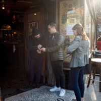 Customers have their vaccination status checked outside a bar in San Francisco on Aug. 24.    BLOOMBERG