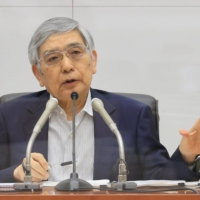Once seen as a symbol of decisive monetary easing, Bank of Japan Gov. Haruhiko Kuroda appears to be taking a back as his program of risky asset purchases has been unsuccessful in managing deflation. | BLOOMBERG