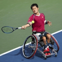Shingo Kunieda hits a shot during the wheelchair tennis men's singles final at the U.S. Open in New York on Sunday.   KYODO