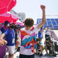 Yuto Horigome gives a salute during the men's street skateboarding finals at the Tokyo Olympics. He took home gold in the event. | KYODO