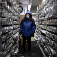 Lonnie Thompson, professor and research scientist at the Ohio State University, stands in a minus 30-degree freezer where ice core samples from glaciers are kept in the Byrd Polar and Climate Research Center in Columbus, Ohio, on Jan. 15. | REUTERS