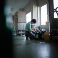 A worker inspects hospital oxygen tanks at the Chiyoda Ltd. oxygen plant in Asaka, Saitama Prefecture, on Aug. 26. | BLOOMBERG