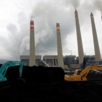 Excavators pile coal in a storage area in an Indonesian Power Plant in Suralaya, Banten province. | REUTERS