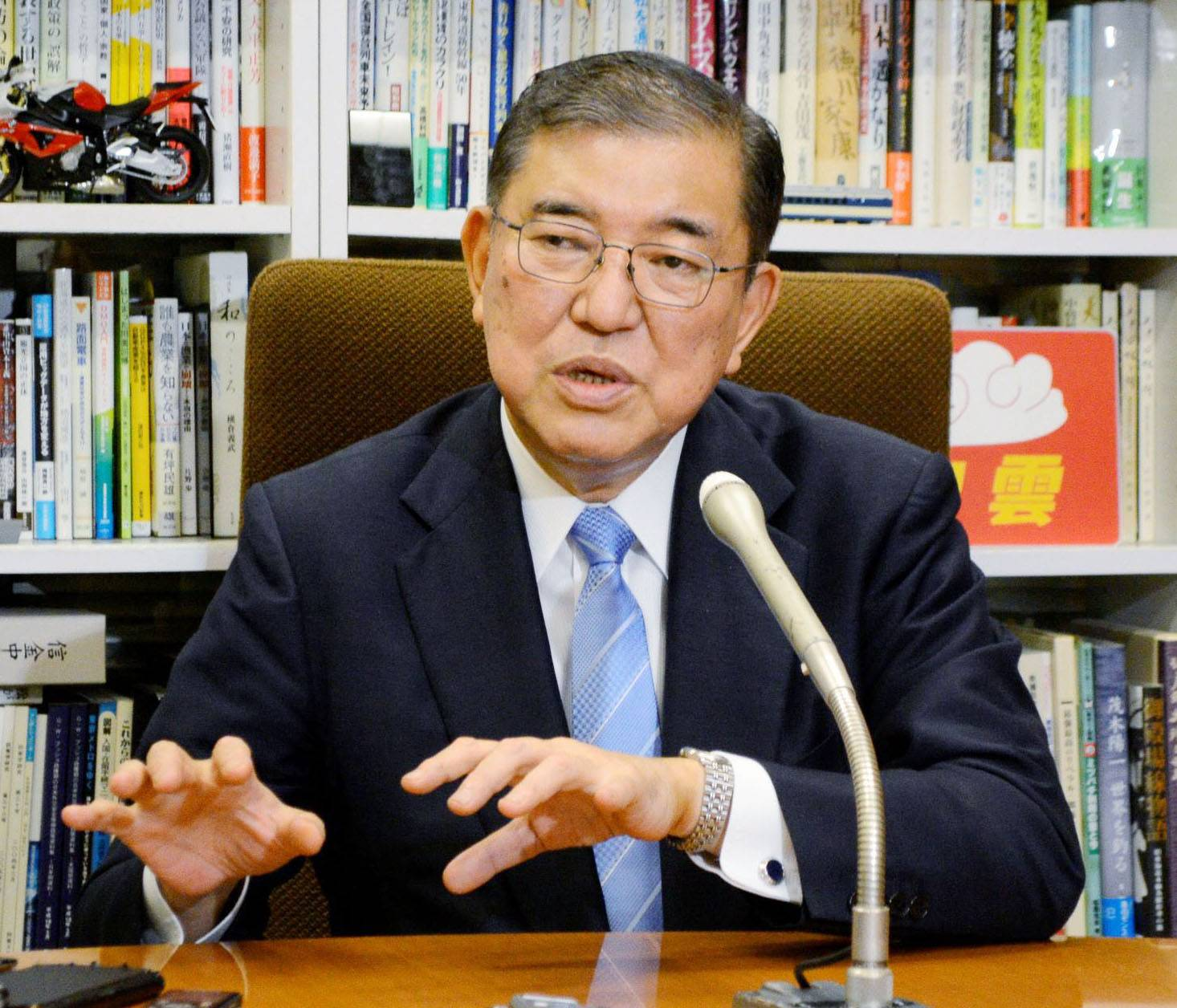 Liberal Democratic Party lawmaker Shigeru Ishiba speaks to reporters after holding talks with Taro Kono, the minister in charge of Japan's vaccine rollout, on Monday in Tokyo. | POOL / VIA KYODO