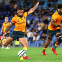 Quade Cooper kicks the game-winning penalty for Australia's Wallabies against South Africa's Springboks in a Rugby Championship match on Sunday in Gold Coast, Australia. | AFP-JIJI
