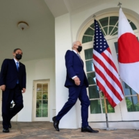 U.S. President Joe Biden walks out of the Oval Office with Prime Minister Yoshihide Suga ahead of a news conference at the White House in Washington in April.   REUTERS