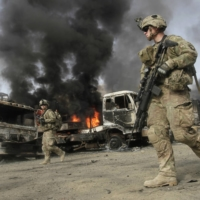 NATO troops respond to an attack by militants in the Torkham area near the Pakistan-Afghan border in Nangarhar province in June 2014. | REUTERS