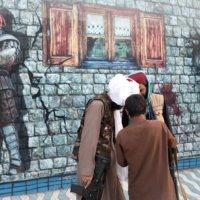 Taliban soldiers at an amusement park in Kabul on Sept. 8 | WEST ASIA NEWS AGENCY / VIA REUTERS