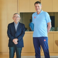 Fast Retailing founder Tadashi Yanai poses with Swedish Olympic Committee CEO Peter Reinebo. | UNIQLO